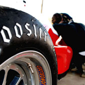 Low profile shot of a Jongbloed JRW 330 wheel and tire on the F1000 race car by Philly Motor Sports