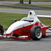 F1000 race car outside on a pavement track