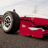 Ground-level view of the right side of the Philly Motor Sports F1000 race car and front wing - Formula B racing