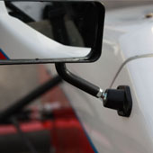 close shot of the driver's side mirror on the F1000 race car