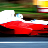 Right side view of the F1000 in motion on an outdoor track