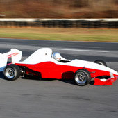 Right view of the F1000 race car from Philly Motor Sports racing on a Formula B outdoor track