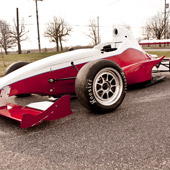 Closeup shot of a 3-piece Jongbloed JRW 330 wheel on the F1000 race car from Philly Motor Sports for Formula B racing