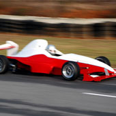F1000 race car speeding down the pavement with blurred background