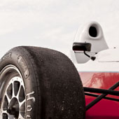 large image of the wheel of the F1000 race car with the cockpit in the rear of the image