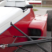 Upper A-arms and view of the aluminum radiator on the left side of the F1000 race car